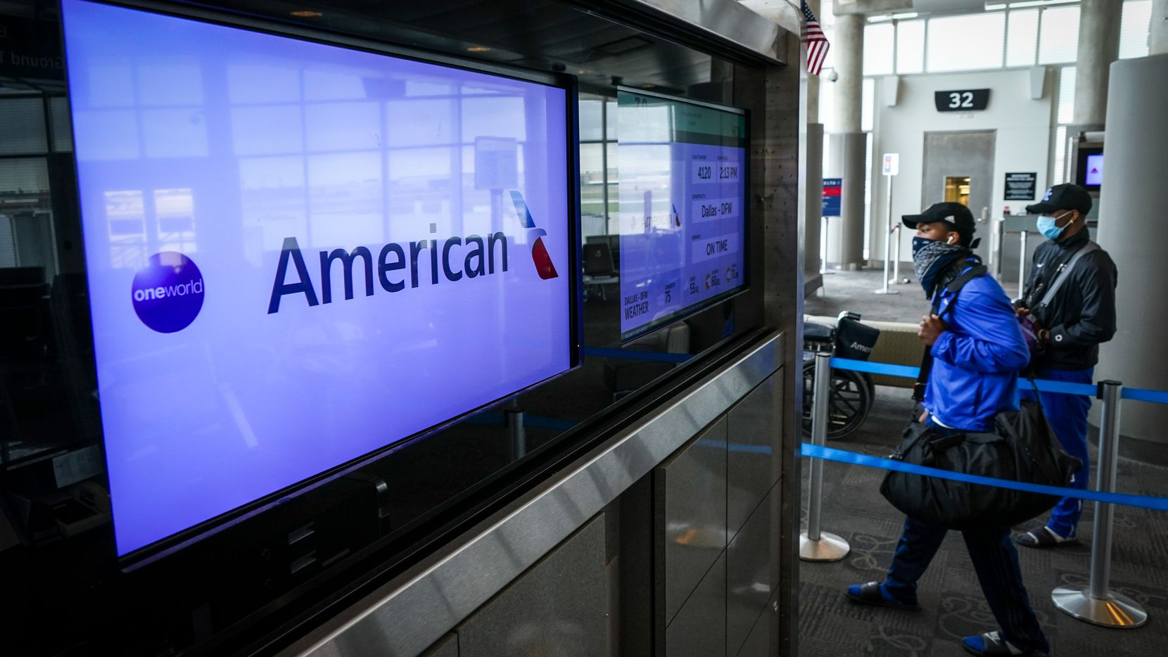 Passengers wearing face masks due to the new coronavirus board an American Airlines flight to DFW Airport at Hobby Airport in Houston on Friday, March 20, 2020. The American Eagle  CRJ-900 regional jet configured to seat 103 passengers carried 19 on the flight.  (Smiley N. Pool/TheDallas Morning News)
