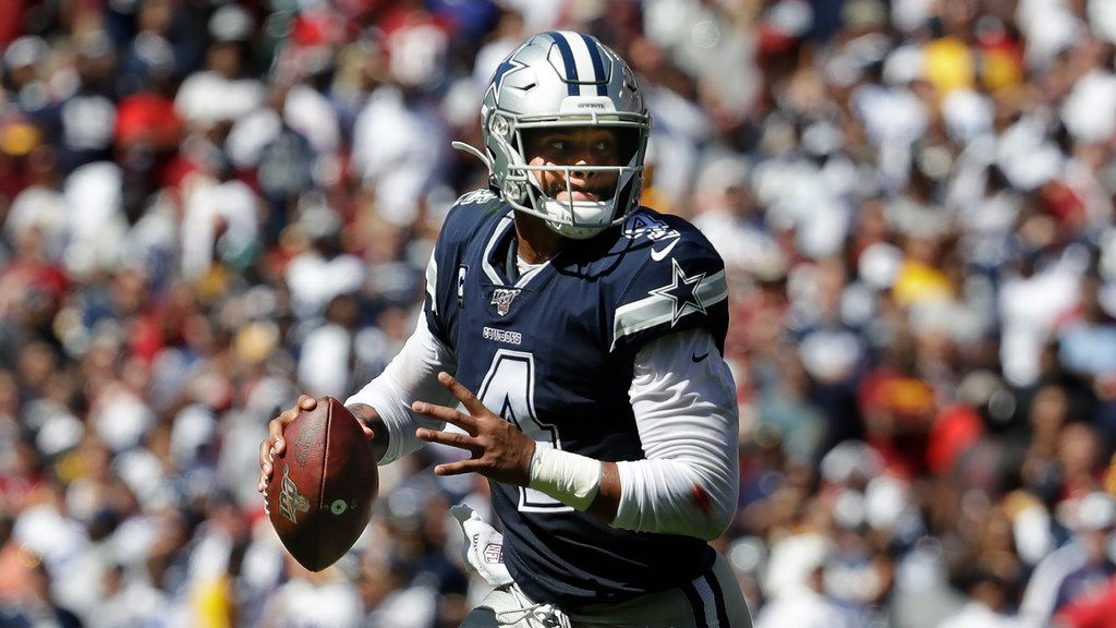 Dallas Cowboys quarterback Dak Prescott (4) with the ball during first half of an NFL football game against the Washington Redskins, Sunday, Sept. 15, 2019, in Landover, Md. (AP Photo/Evan Vucci)