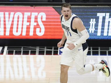 Dallas Mavericks guard Luka Doncic (77) celebrates a made basket during the first half of an NBA playoff basketball game against the LA Clippers at Staples Center on Saturday, May 22, 2021, in Los Angeles.