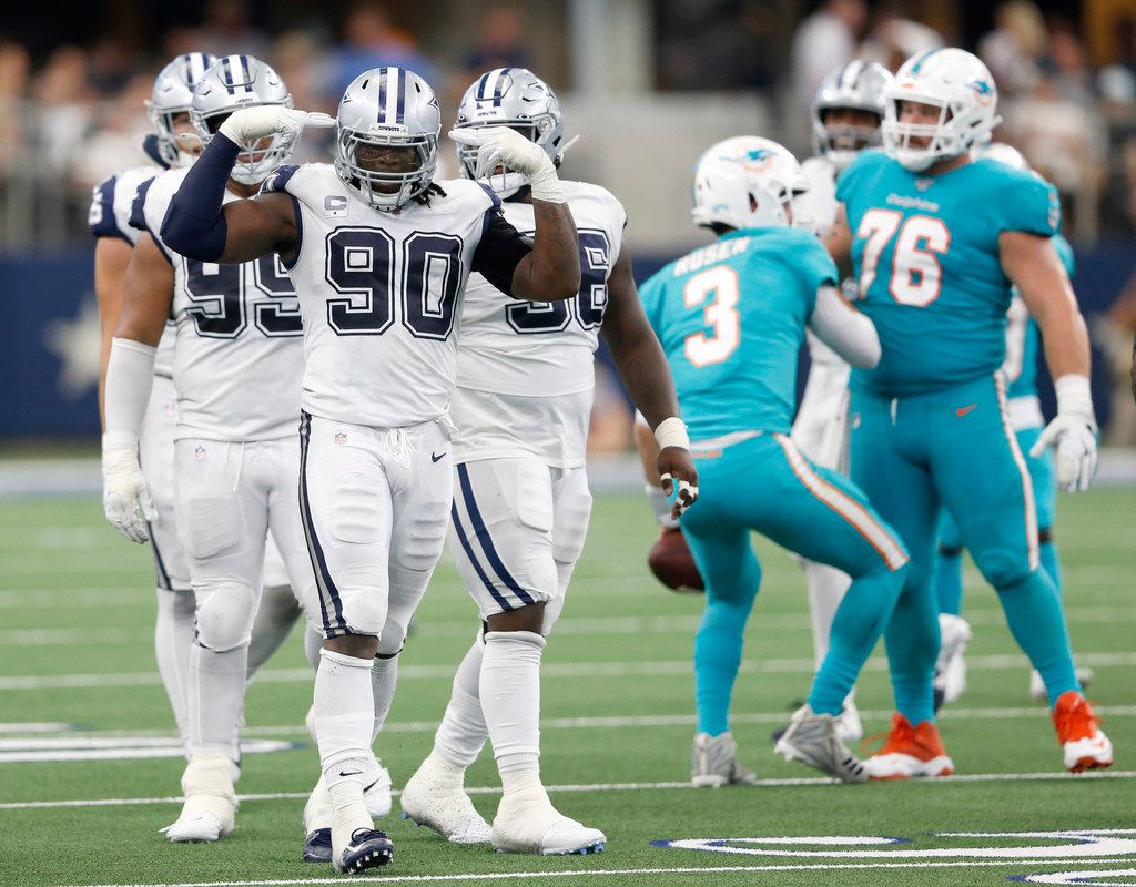 Dallas Cowboys defensive end Demarcus Lawrence (90) celebrates after sacking Miami Dolphins quarterback Josh Rosen (3, background) during the second half of play at AT&T Stadium in Arlington, Texas on Sunday, September 22, 2019. The Dallas Cowboys defeated the Miami Dolphins 31-6.