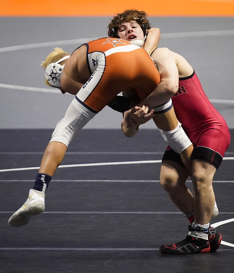 Kenneth Hendriksen of Carrollton Creekview (top) wrestles Jayden Bustillos of El Paso Riverside for the 5A boys 113-pound championship during the UIL State Wrestling tournament at the Berry Center on Friday, April 23, 2021, in Cypress, Texas.