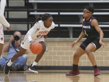 Mansfield Legacy guard Coniah Cooley (00) drives against the defense of Mansfield Timberview's Tamaiya Mims (1) during first half action. The two teams played their District 8-5A girls basketball game at Mansfield Legacy High school on January 22 , 2021. (Steve Hamm/ Special Contributor)
