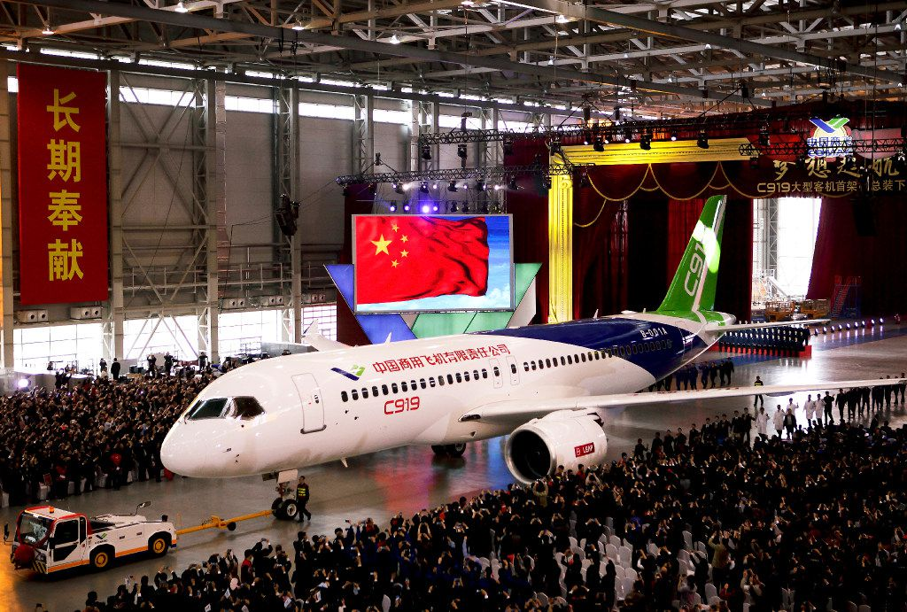 In this Monday, Nov. 2, 2015 file photo, the first twin-engine 158-seater C919 passenger plane made by The Commercial Aircraft Corp. of China (COMAC) is pulled out of the company's hangar during a ceremony near the Pudong International Airport in Shanghai, China.  (AP Photo, File)