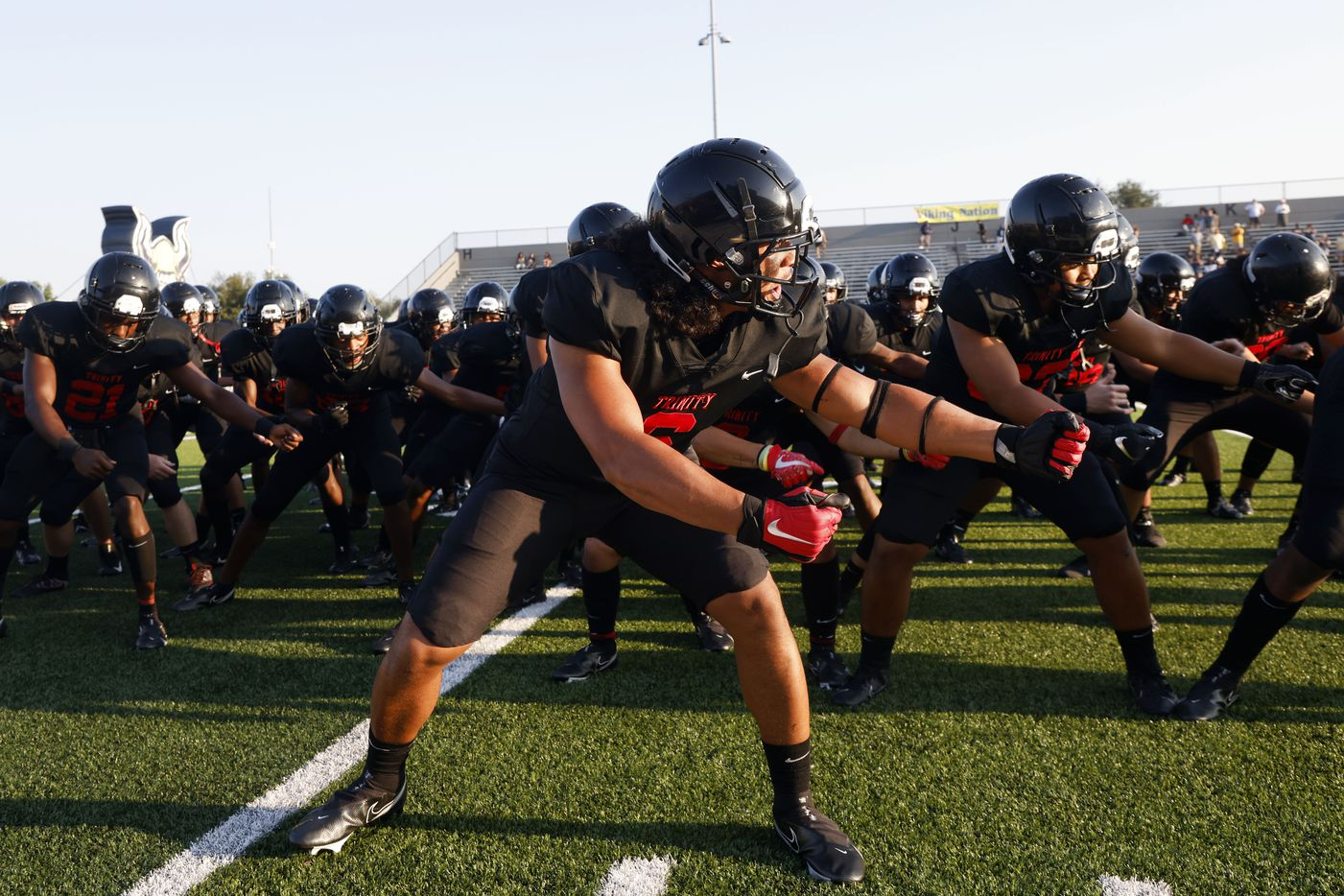 Euless Trinity defender Nai Mose leads the team in the haka dance prior to playing Arlington Lamar during their high school football game in Bedford, Texas on Aug. 26, 2021. (Michael Ainsworth/Special Contributor)