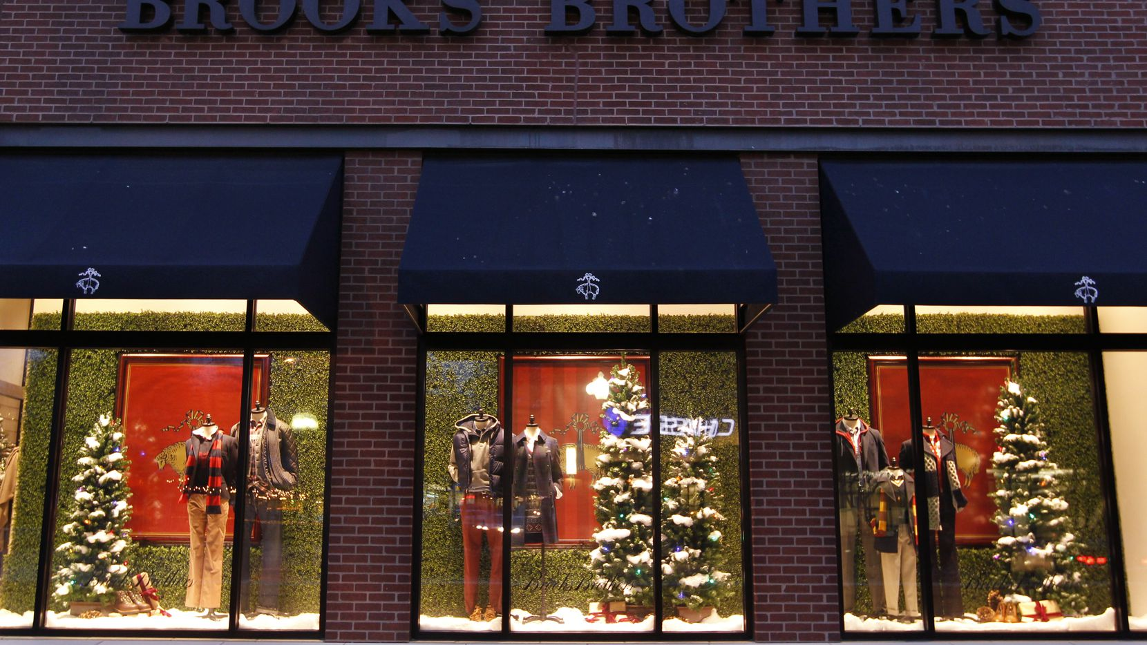 The holiday windows at Brooks Brothers on McKinney Avenue in the West Village of Uptown Dallas from a Christmas past. The storied men's apparel retailer filed for Chapter 11 on Wednesday.