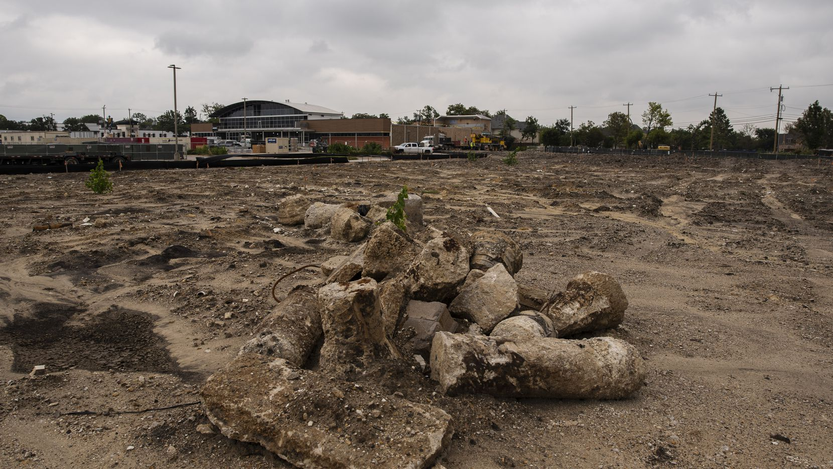 A pile of rubble is shown in the foreground where the Regency Center was located and the ongoing construction for a Central Market, background, at the Preston Oaks shopping center in Dallas, on Oct. 15, 2020. The grocery store and shopping center were badly damaged during a tornado a year ago. The Central Market is scheduled to reopen in 2021.