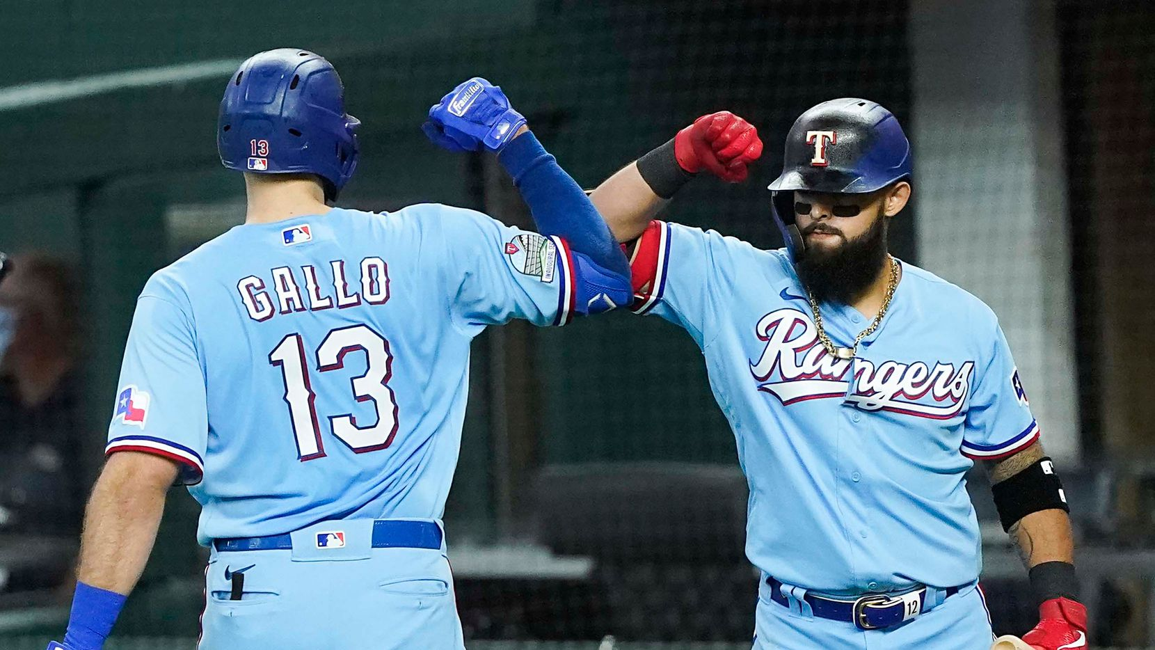 Texas Rangers outfielder Joey Gallo celebrates with second baseman Rougned Odor after hitting the first official home run in the history of the new ballpark during the second inning against off of Colorado Rockies starting pitcher Kyle Freeland at Globe Life Field on Sunday, July 26, 2020.