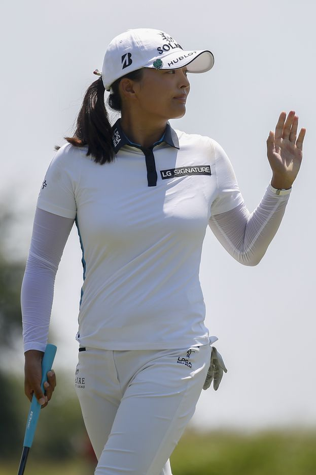 Professional golfer Jin Young Ko waves to the crowd after making birdie on the No. 4 during the final round of the LPGA VOA Classic on Sunday, July 4, 2021, in The Colony, Texas. (Elias Valverde II/The Dallas Morning News)
