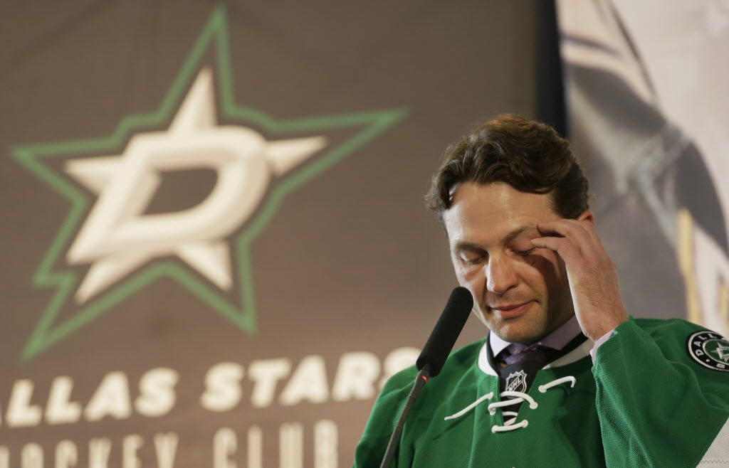 Dallas Stars' Brenden Morrow pauses to compose himself as he speaks during his retirement news conference Thursday, March 17, 2016, in Dallas. Morrow is retiring after a 15-year career  by signing a ceremonial one-day contract with the Stars. (AP Photo/LM Otero)