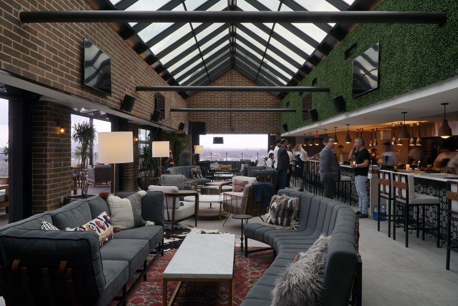 Ático has large couches sitting atop large area rugs. It has a lived-in feeling despite being a brand-new bar in a brand-new hotel.