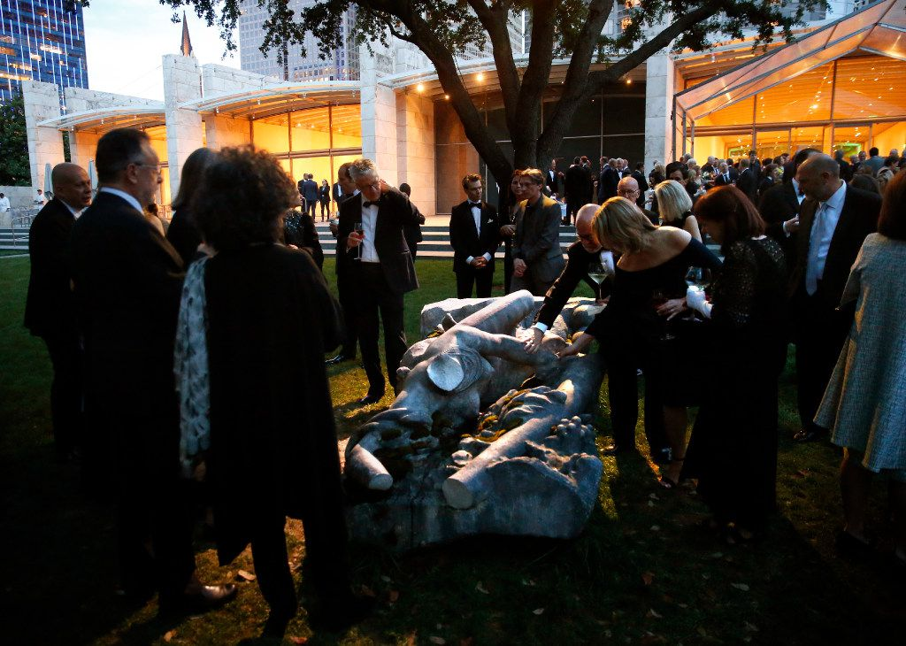 Guests feel the heated concrete sculpture La déraison by French artist Pierre Huyghe.  The piece is on display at the Nasher Sculpture Center in Dallas, Saturday, April 1, 2017. Huyghe is the second recipient of the Nasher Prize for Sculpture award. (Tom Fox/The Dallas Morning News)