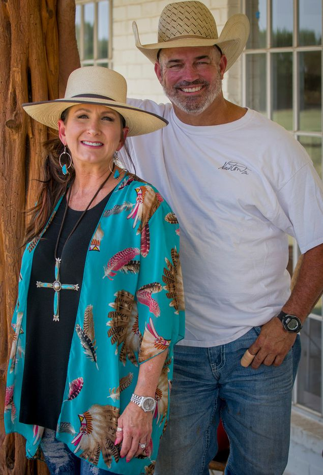 "Melanie and Mike Newton on the front porch of their Lipan, Texas ranch house on July 17, 2018. Mike is known as the Cowboy Chef and jokes about having an ""ugly kitchen"" in their home. (Robert W. Hart/Special Contributor)"