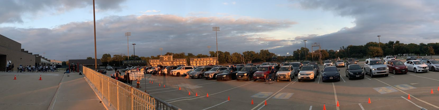 A photo displays the setup of last week's McKinney High School orchestra concert, which saw students perform on the loading dock and the music broadcast to spectators in their cars or practicing social distancing in front of the loading dock.