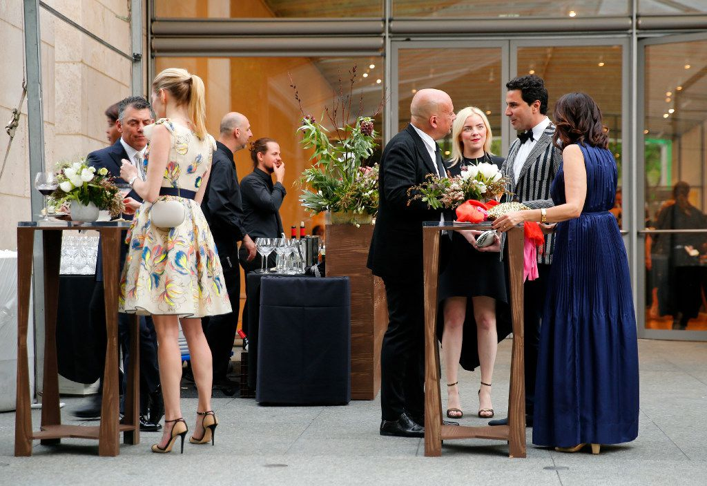 Guests enjoy drinks before a dinner and ceremony honoring French artist Pierre Huyghe as the second recipient of the Nasher Prize for Sculpture at the Nasher Sculpture Center in Dallas, Saturday, April 1, 2017. (Tom Fox/The Dallas Morning News)