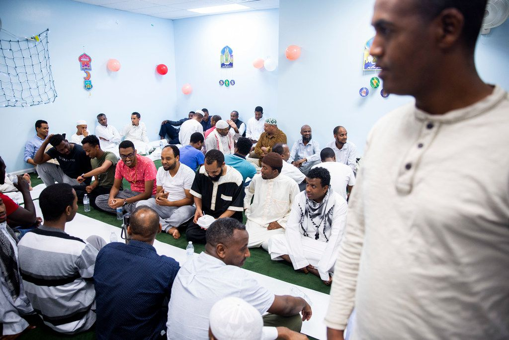 People gather to break their fast at the Ethiopian Community Center In Garland, Texas on Saturday, May 25, 2019. (Shaban Athuman/Staff Photographer)