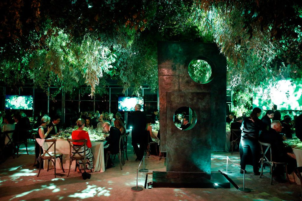 A large tent and flora were built around the existing trees and sculptures at the Nasher Sculpture Center in Dallas .The tables are set for dinner honoring French artist Pierre Huyghe, the second recipient of the Nasher Prize Award for Sculpture, Saturday, April 1, 2017. (Tom Fox/The Dallas Morning News)