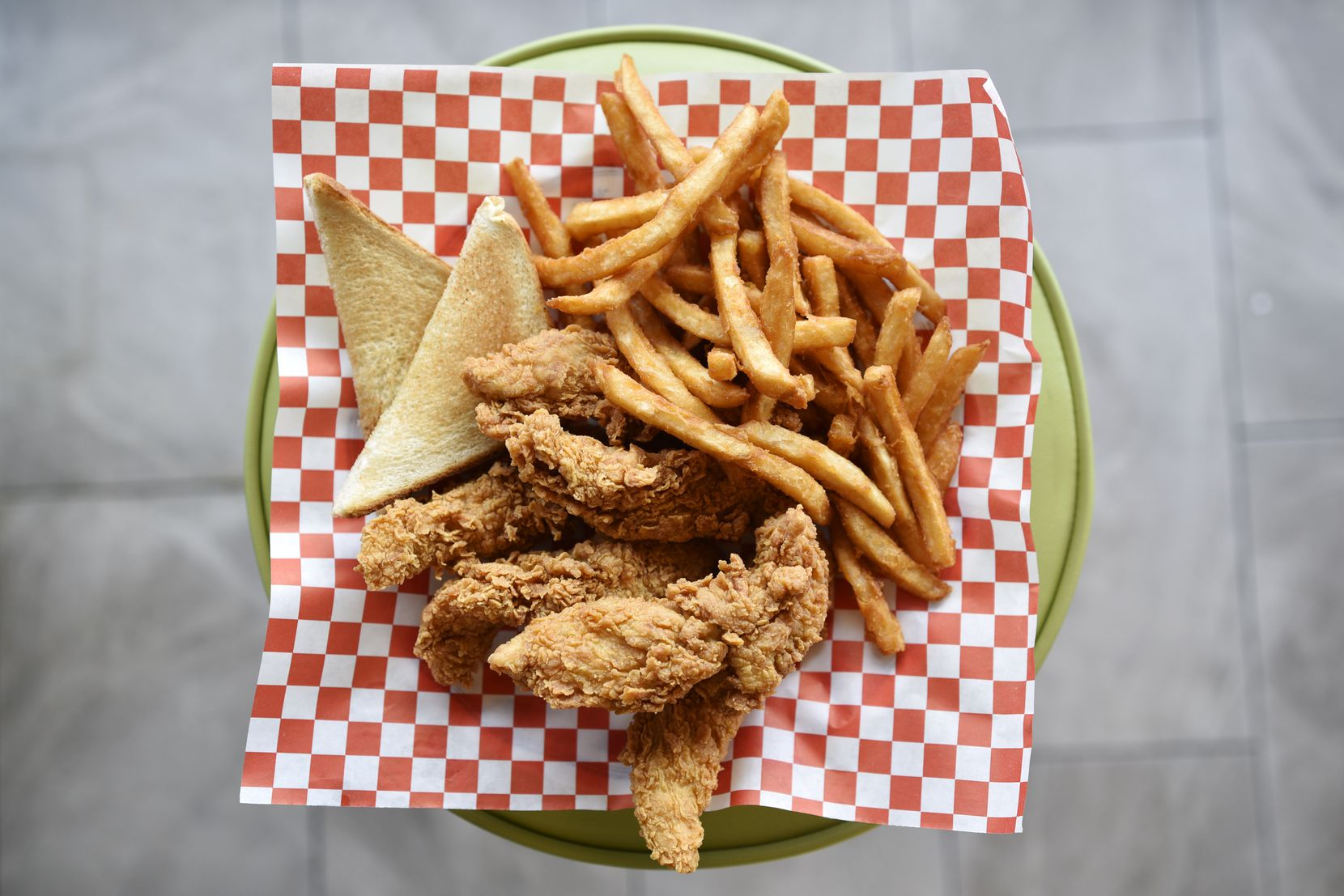 An order of chicken tenders, fries and toast from Mike's Chicken on Maple Avenue in Dallas