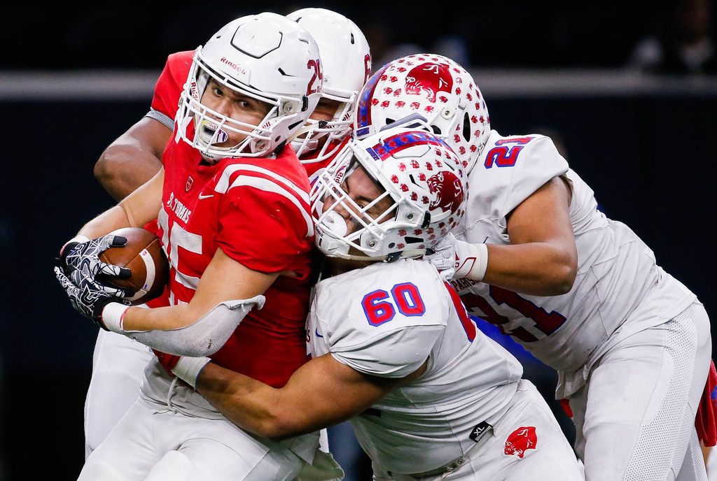 Parish EpiscopalÕs Josue Munoz (60) and Keegon Addison (21) tackle Houston St. ThomasÕ John Fontenot (25) in the third quarter of a TAPPS Division I state semifinal game at the Star in Frisco, on Saturday, November 30, 2019. Parish Episcopal won 41-21. (Juan Figueroa/The Dallas Morning News)