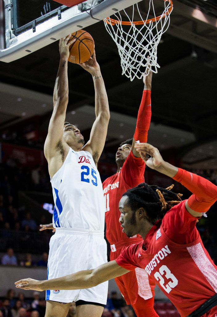 Southern Methodist Mustangs forward Ethan Chargois (25) dunks the ball during the first half of a basketball game between SMU and University of Houston on Saturday, February 15, 2020 at Moody Coliseum in Dallas. (Ashley Landis/The Dallas Morning News)