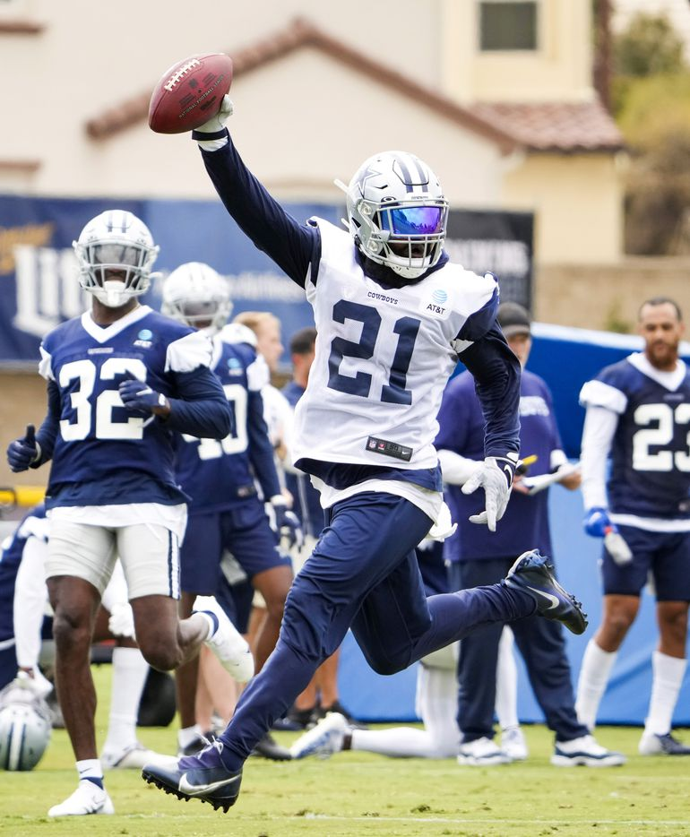 Dallas Cowboys running back Ezekiel Elliott (21) races for a touchdown past safety Jayron Kearse (32) during a practice at training camp on Saturday, July 24, 2021, in Oxnard, Calif.