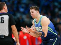 Dallas Mavericks forward Luka Doncic (77) disputes a call by referee David Jones (36) during the first half of a NBA matchup between the Dallas Mavericks and the Sacramento Kings on Sunday, Dec. 8, 2019 at American Airlines Center in Dallas.