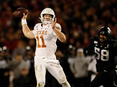Texas quarterback Sam Ehlinger (11) throws a pass ahead of Iowa State defensive lineman Ray Lima (58) during the second half of an NCAA college football game, Saturday, Nov. 16, 2019, in Ames, Iowa. Iowa State won 23-21.