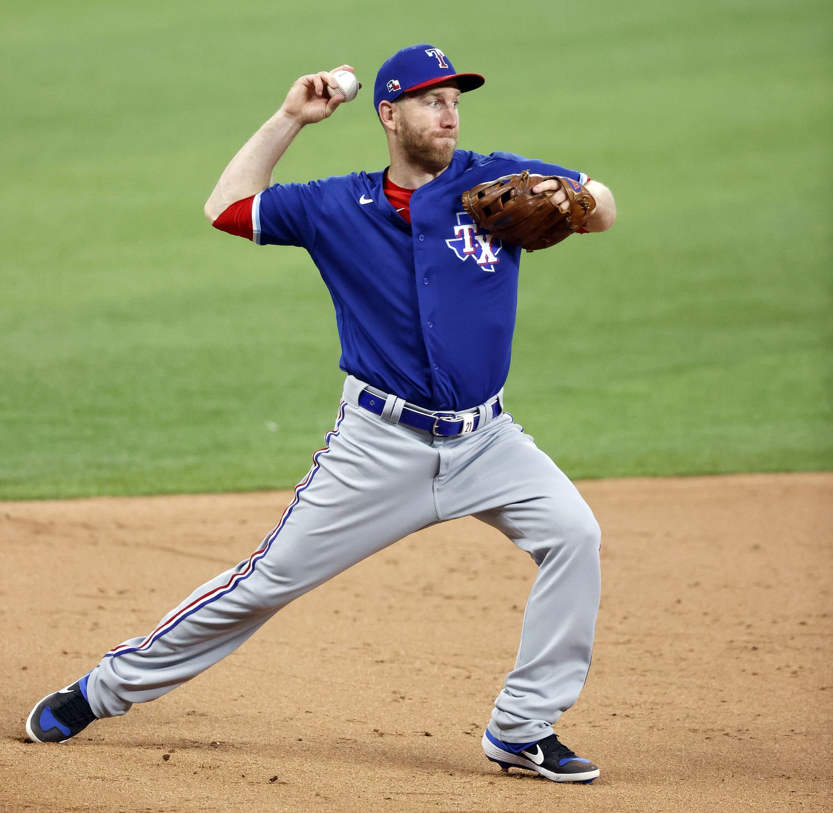 Texas Rangers third baseman Todd Frazier fields an infield ball and makes the play at first during an intrasquad game at Summer Camp inside Globe Life Field in Arlington, Texas, Friday, July 10, 2020. (Tom Fox/The Dallas Morning News)