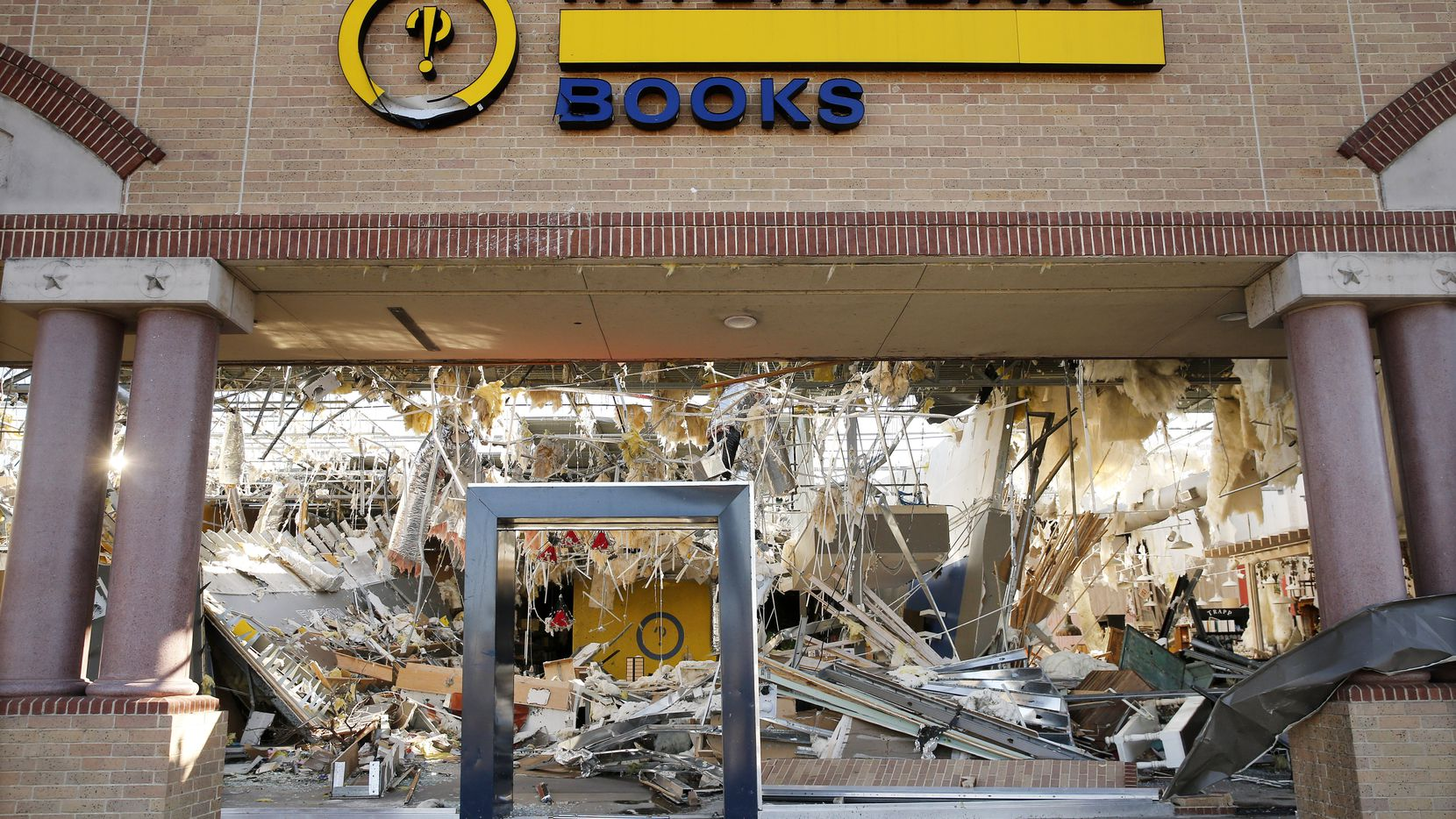 The interior of the Interabang Books store was demolished by a tornado in the Preston Royal shopping center in Dallas, Monday, October 21, 2019.