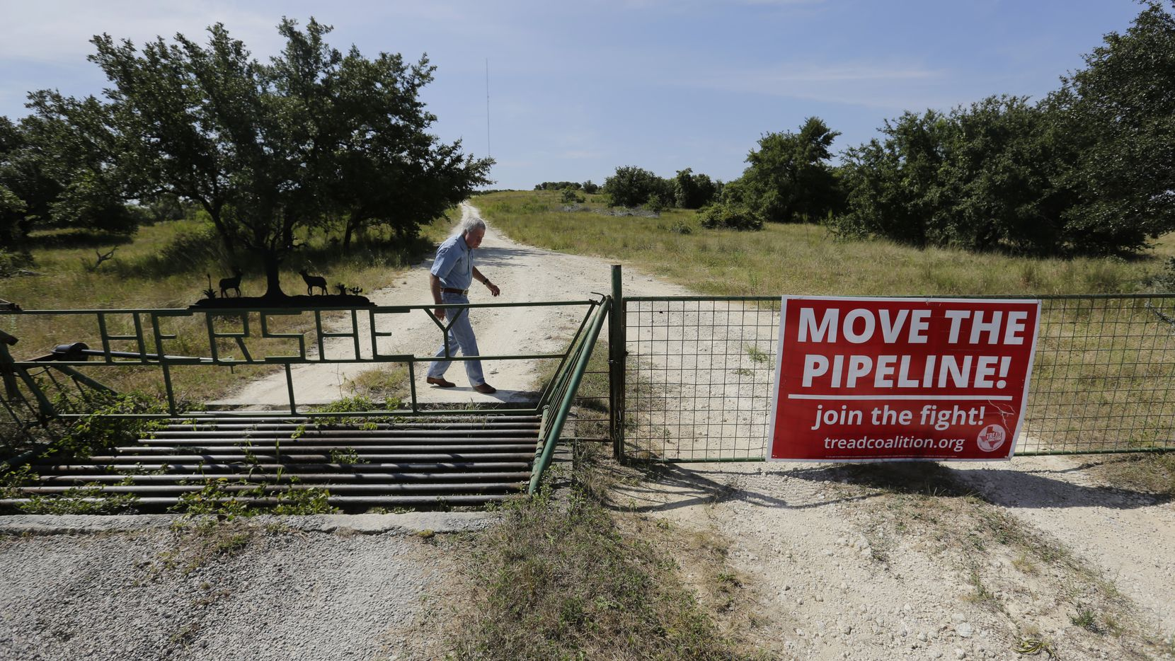 Andy Sansom walks on his property where a proposed new natural gas pipeline would pass through his ranch near Stonewall, Aug. 2, 2019. A proposed pipeline is a 430-mile, $2 billion natural gas expressway that pipeline company Kinder Morgan has mapped from the West Texas oil patch to Houston.