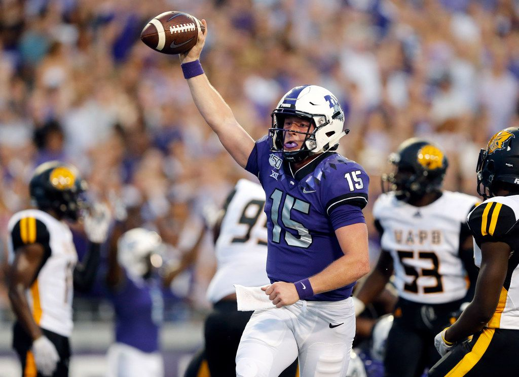 TCU Horned Frogs quarterback Max Duggan (15) ducked under a defender and ran in a first quarter touchdown against the Arkansas-Pine Bluff Golden Lions  at Amon G. Carter Stadium in Fort Worth Texas, Saturday, August 31, 2019. (Tom Fox/The Dallas Morning News)