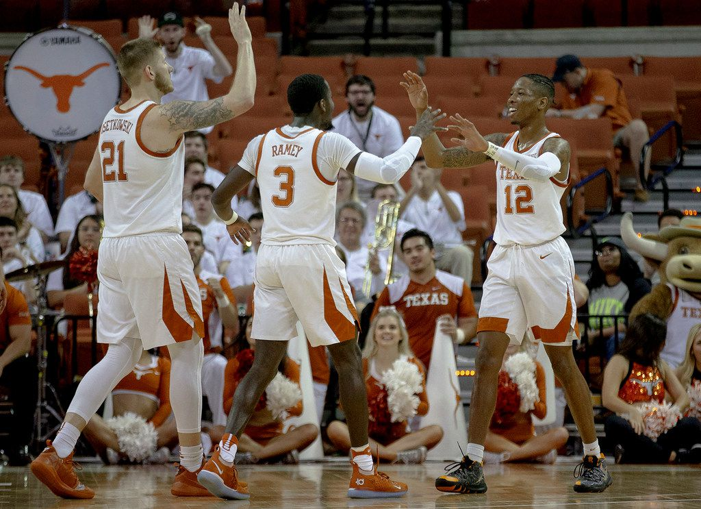 Texas guard Kerwin Roach II (12) celebrates a score with forward Dylan Osetkowski (21) and guard Courtney Ramey (3) during an NCAA college basketball game in the second round of the NIT on Sunday, March 24, 2019, in Austin, Texas. (Nick Wagner/Austin American-Statesman via AP)
