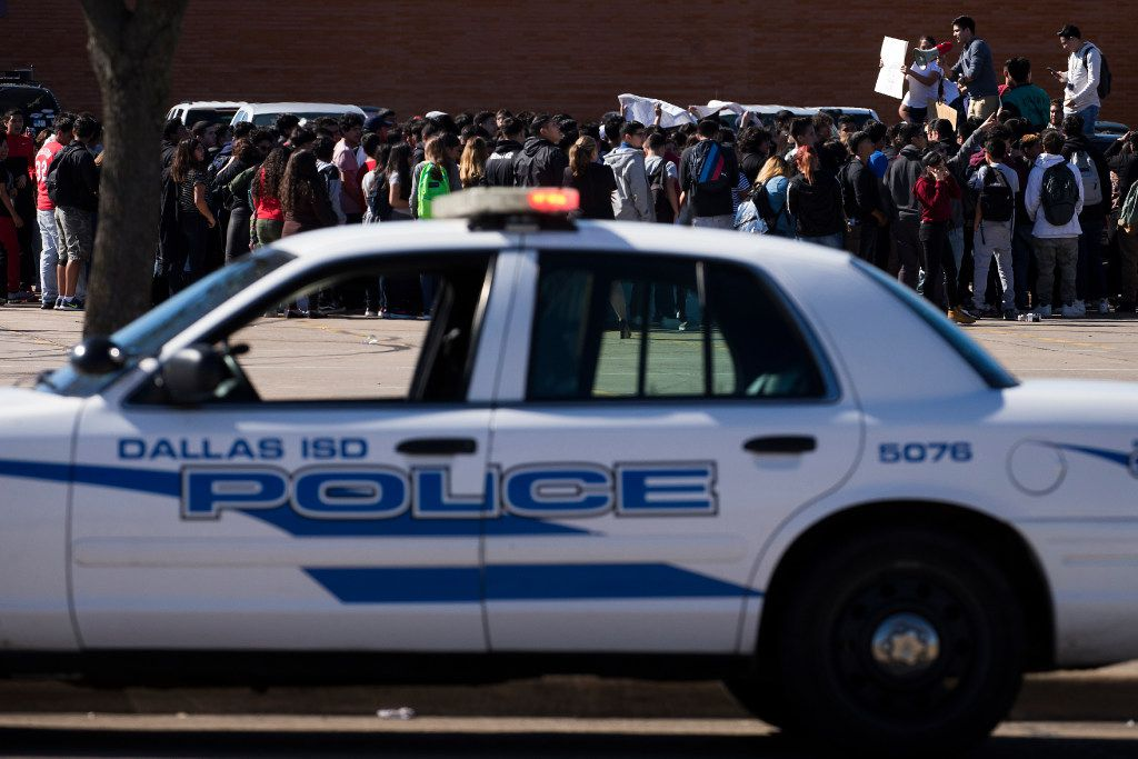 "Students at Molina High School walk out of class and rally in the parking lot in support of ""A Day Without Immigrants"" on Thursday, Feb. 16, 2017, in Dallas. (Smiley N. Pool/The Dallas Morning News)"