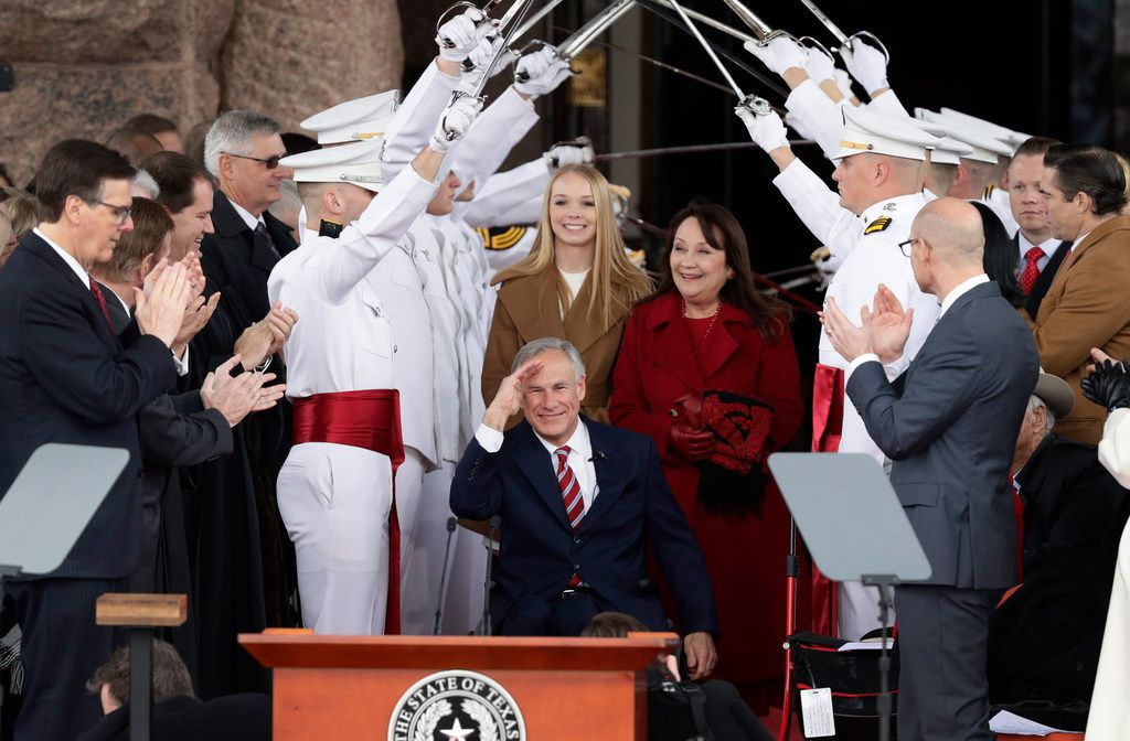 Texas Gov. Greg Abbott (front center) was sworn in last month as his wife, Cecilia, and daughter, Audrey, watched. Lt. Gov. Dan Patrick, who also took his second term oath of office and gave a speech, is at far left..