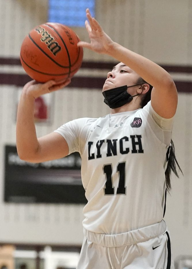 Dallas Bishop Lynch's Talia Depetrillo (11) makes a three point basket against The Village School during the TAPPS 6A girls basketball championship game at A&M Consolidated High School in College Station, Texas on Friday, March 12, 2021. (Sam Craft/Special Contributor)