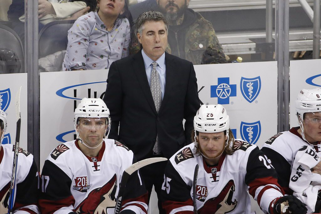 FILE - In this Dec. 12, 2016, file photo, Arizona Coyotes coach Dave Tippett stands behind his bench during the team's NHL hockey game against the Pittsburgh Penguins in Pittsburgh. The Coyotes and Tippett have mutually agreed to part ways after eight seasons. The 55-year-old Tippett led the Coyotes through four years of being run by the NHL after the team went into bankruptcy and took the Coyotes to the 2012 Western Conference Finals. He went 282-257-83 in the desert. (AP Photo/Gene J. Puskar, File)