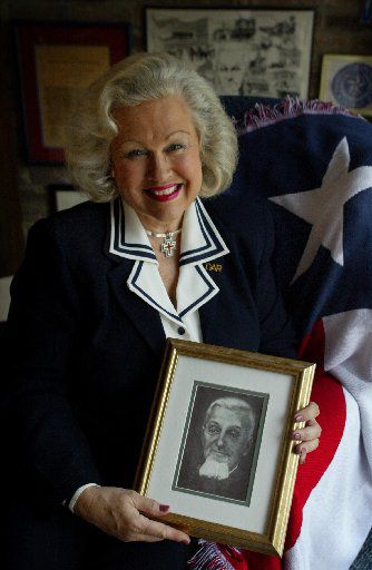 Dallas native Pat Spackey  holds a portrait of her great-great grandfather, Dr. Charles Bellinger, who was a major figure in the Texas Revolution and is often credited with having designed the Texas flag.