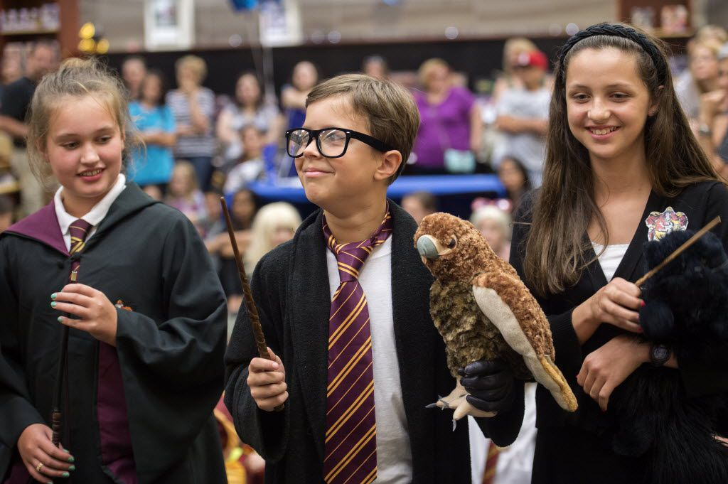 """Braden Hines, 11, center, dressed as Harry Potter, awaits the announcement of his victory in a costume contest at a release party for the new Harry Potter book """"Harry Potter and the Cursed Child"""" on Saturday, July 30, 2016 at the Barnes & Noble bookstore on W. 15th Street in Plano, Texas."""