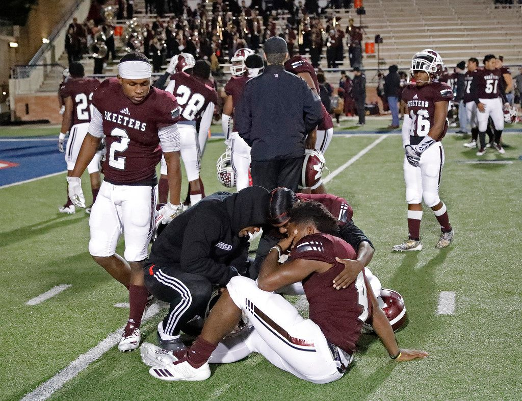 Mesquite High School running back Ladarius Turner (4) is comforted by team mates after being eliminated by Prosper High School in a Class 6A Division I area-round playoff game at Eagle Stadium in Allen on Friday night, November 22, 2019. (Stewart F. House/Special Contributor)