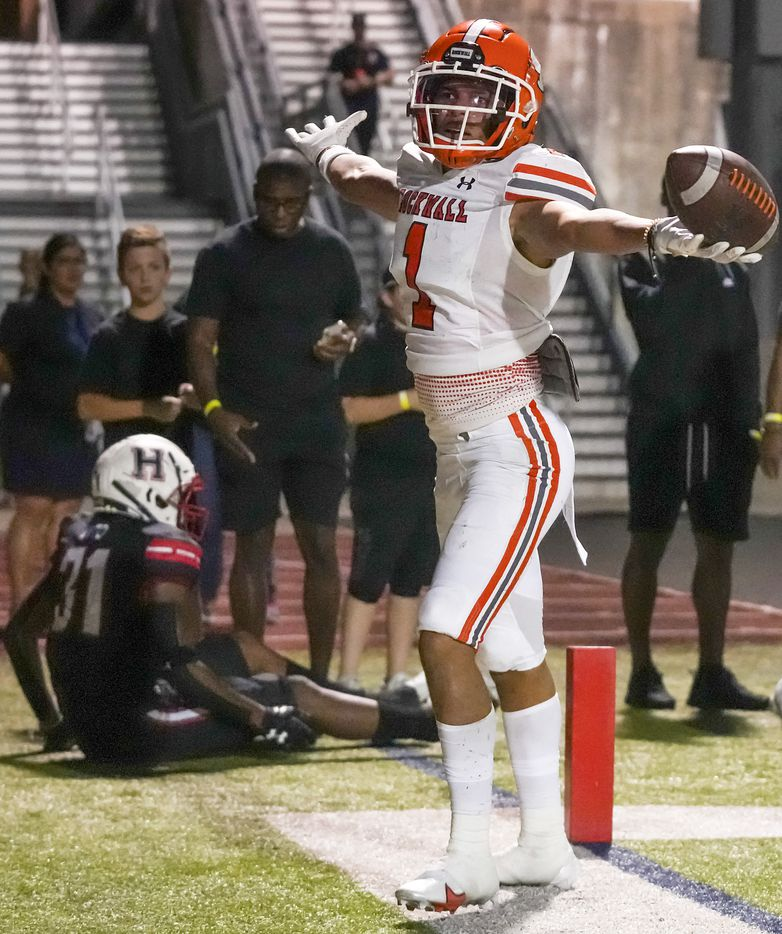 Rockwall wide receiver Aiden Meeks (1) celebrates after catching a 15-yard touchdown pass from running back Zach Hernandez during the second half of a District 10-6A high school football game against Rockwall-Heath at Wilkerson-Sanders Stadium on Friday, Sept. 24, 2021, in Rockwall.  Rockwall-Heath won the game 79-71 in double overtime.