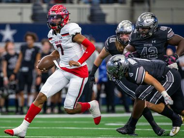 Cedar Hill quarterback Kaidon Salter (7) maneuvers past Denton Guyer defense during the Class 6A Division II area-round high school football playoff game at the AT&T Stadium in Arlington, Texas, on Saturday, November 23, 2019.