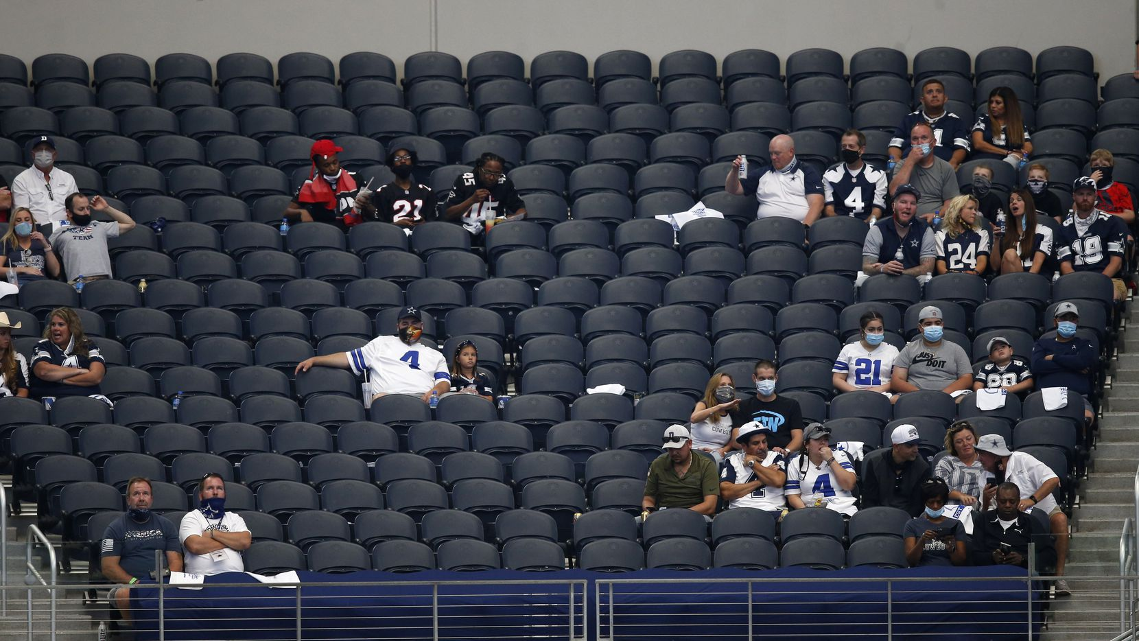 Dallas Cowboys fans watch the game between the Dallas Cowboys and Atlanta Falcons in the home opener at AT&T Stadium in Arlington, Texas on Sunday, September 20, 2020.