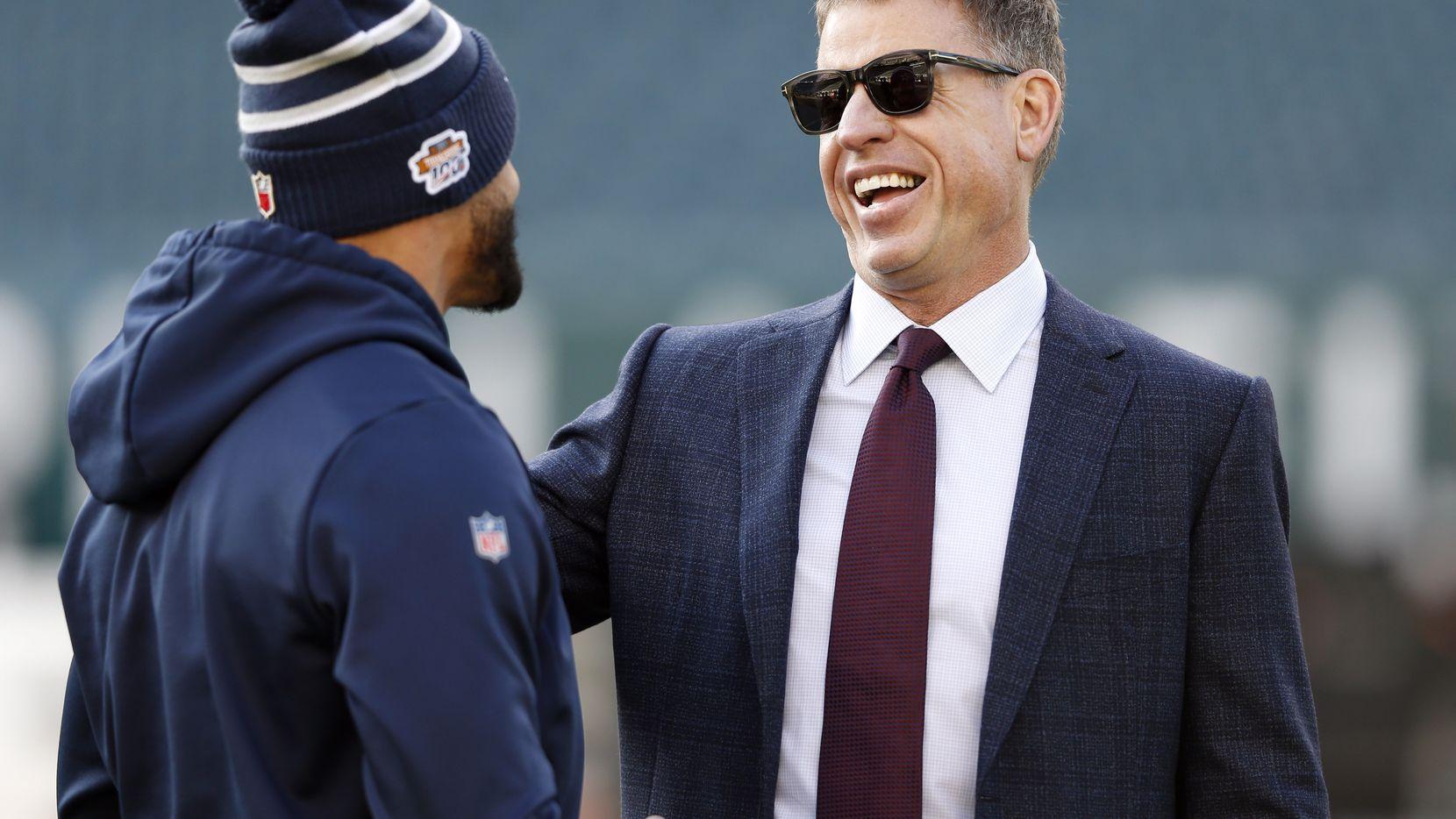 Dallas Cowboys quarterback Dak Prescott (4) shares a laugh with former Dallas Cowboys quarterback Troy Aikman before a game against the Philadelphia Eagles at Lincoln Financial Field in Philadelphia on Sunday, December 22, 2019.