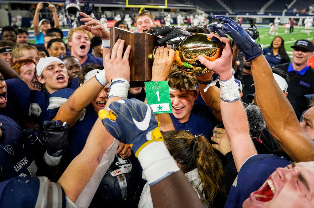 Frisco Lone Star Head celebrate with the game trophy after the Rangers a 33-27 overtime victory over Highland Park in a Class 5A Division I Region II semifinal playoff football game at AT&T Stadium non Friday, Nov. 29, 2019, in Arlington. (Smiley N. Pool/The Dallas Morning News)