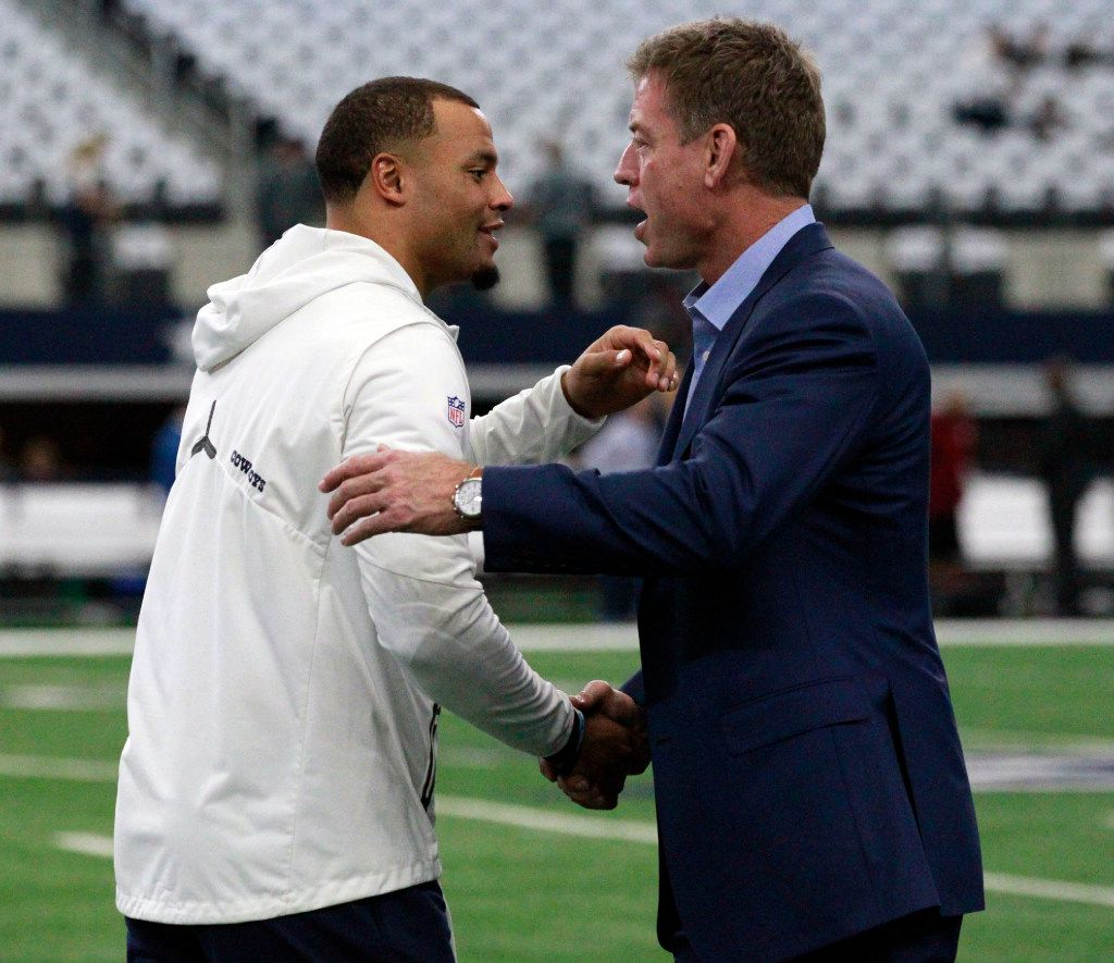 Dallas Cowboys quarterback Dak Prescott (4) greets former Dallas Cowboys QB Troy Aikman before the start of the first half of a NFL football game between the Dallas Cowboys and the Washington Redskins on Thursday, November 24, 2016. (John F. Rhodes / Special Contributor)