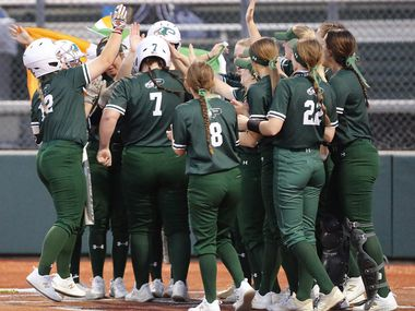 Prosper High School first baseman Sydney Lewis (7) is mobbed by team mates after hitting a two run homer in the second inning as Prosper High School hosted McKinney High School in a district 5-6A softball game played at Prosper High School on Tuesday , March 16, 2021.  (Stewart F. House/Special Contributor)