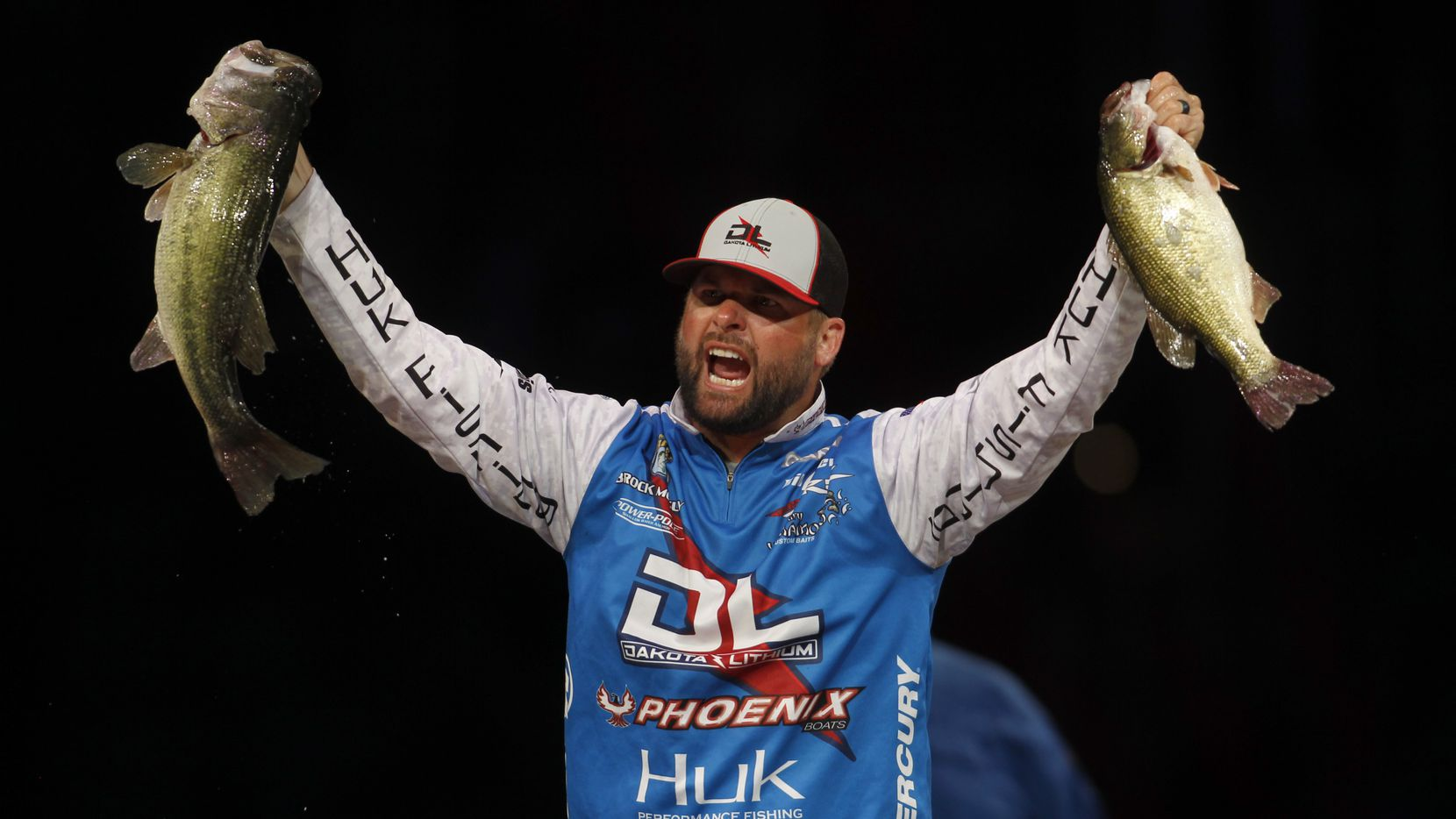 Brock Mosley lets out a yell while raising two of five fish he netted for a combined weight of 19 lbs.,1 ounce which topped all anglers on the final day of fishing. Mosley finished 5th in the tournament standing with a combined total weight of 42 pounds. The final weigh-in for the 51st Bassmaster Classic fishing tournament was held at Dickies Arena in Fort Worth on June 13, 2021.