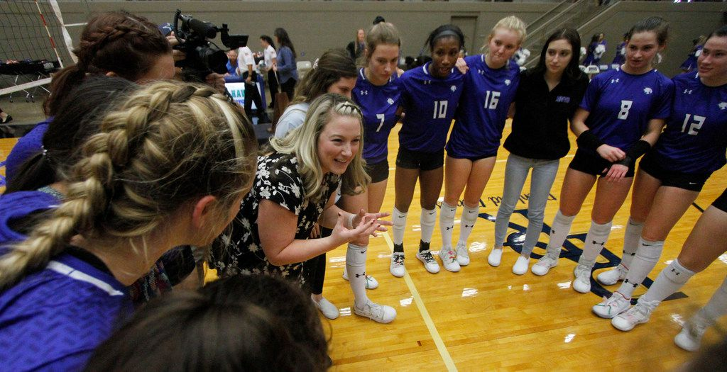 Trophy Club Byron Nelson head volleyball coach Brianne Barker-Groth is unable to contain her excitement as she shares words of encouragement to her Lady Bobcats players after they defeated Denton Guyer in straight sets to advance to the state tournament. The two teams played their Class 6A Region l championship volleyball match at W.G. Thomas Coliseum in Haltom City on November 16, 2019. (Steve Hamm/ Special Contributor)