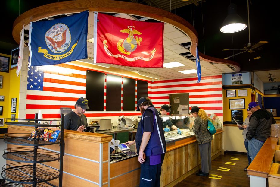 Customers stand in line at Patriot Sandwich Company on Feb. 18, 2020 in Denton. The shop pays tribute to all branches of the military and a portion of the profits go to We Got Your Six, a nonprofit that supports homeless veterans in their transition back to civilian life.