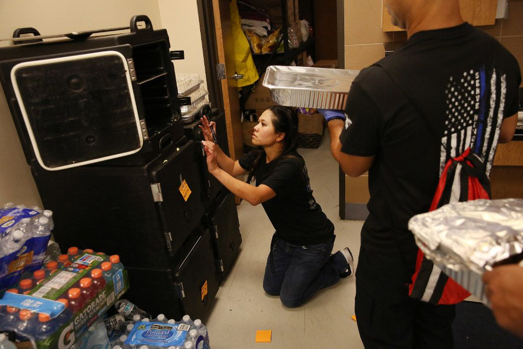 Jennifer Do labels food as she brings order to the kitchen at the Houston Police Officers' Union on Wednesday. Do and her friend Dory Fung have been managing the food donations streaming in for officers.