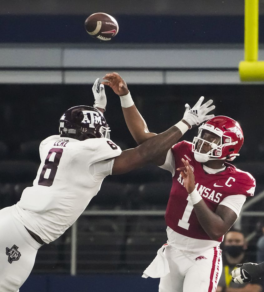 Arkansas quarterback KJ Jefferson (1) throws a pass as Texas A&M defensive lineman DeMarvin Leal (8) applies pressure during the second half of an NCAA football game at AT&T Stadium on Saturday, Sept. 25, 2021, in Arlington. Arkansas won the game 20-10.